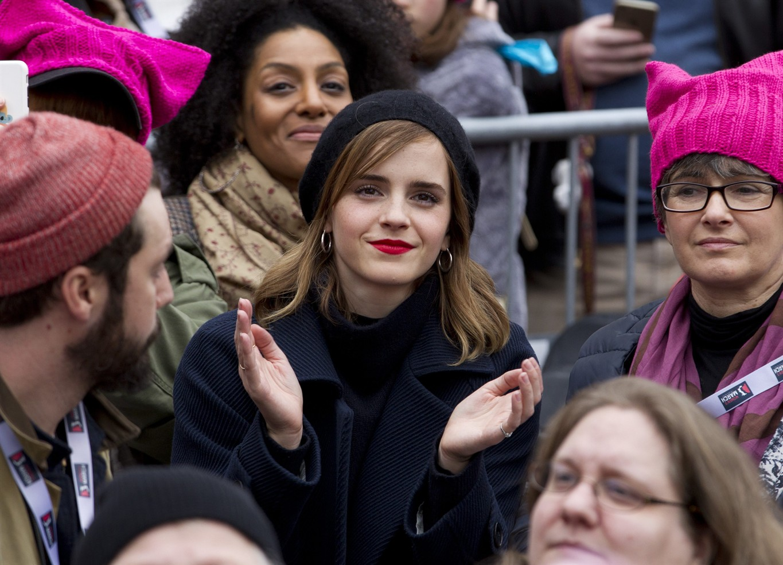 Actress Emma Watson sits in the crowd during the Women's March on Washington, Saturday, Jan. 21, 2017 in Washington. (AP Photo/Jose Luis Magana)